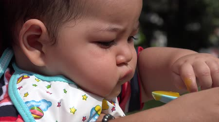 infant formula : Baby Eating Infant Feeding Stock Footage