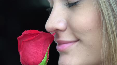 senhora : Woman Smelling Flowers
