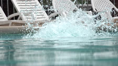 basen : Woman Diving into Swimming Pool