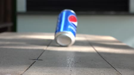 drink cans : Editorial: Soda Can Blowing in Wind