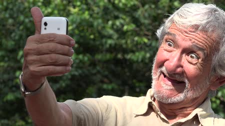 fotos : Old Man Taking Selfie Videos