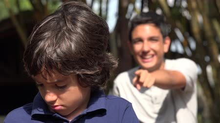 taunting : Brother Teasing Younger Brother Stock Footage