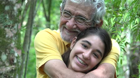 yetişkinler : Grandfather and Granddaughter Outdoors Stok Video