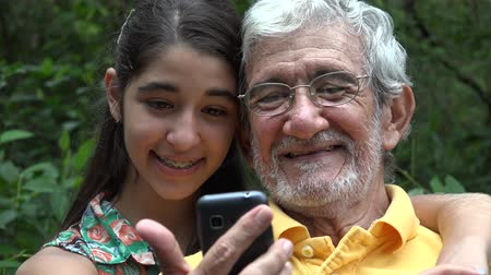 fotky : Grandfather and Granddaughter Selfie Dostupné videozáznamy