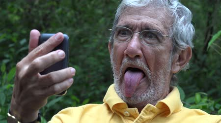 garip : Elderly Old Man Taking Selfie