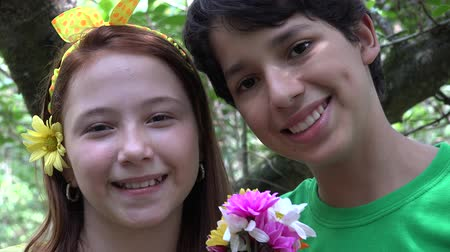 eighteen : Teen Siblings or Friends in Forest Stock Footage