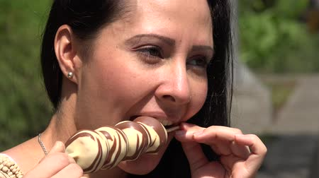 snack : Hispanic Woman Eating Chocolate Dessert