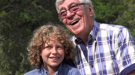 maço : Grandfather and Grandson Outdoors Stok Video