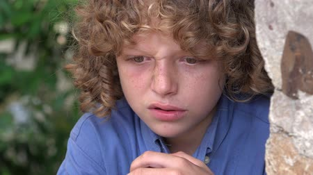 огорчен : Sad and Angry  Boy with Curly Hair