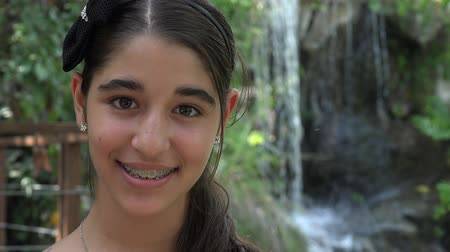 braces on teeth : Teen Girl Smiliing in Nature