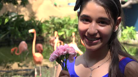 eighteen : Teen Girl and Flowers in Nature Stock Footage