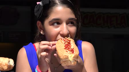 eighteen : Girl Eating Hot Dog Lunch