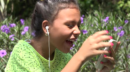 восхищенный : Excited Girl Listening to Earphones Стоковые видеозаписи