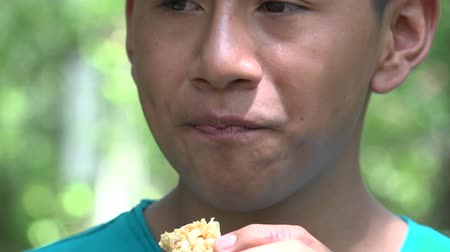Колумбия : Teen Boy Eating Granola Snack