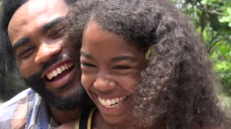 adore : African Father and Daughter or Siblings