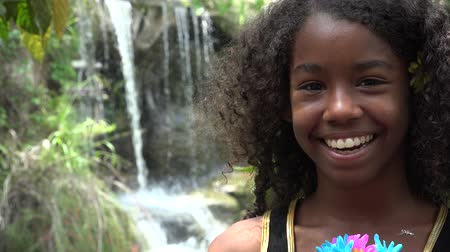 mal cheiroso : African Teen Girl at Waterfall Stock Footage
