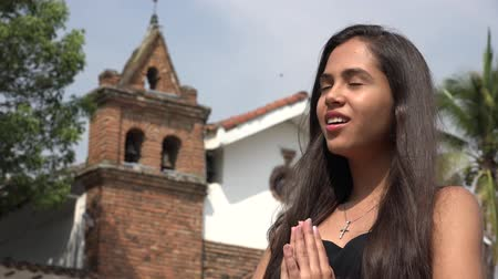 talep : Happy Teen Hispanic Girl Praying at Church Stok Video