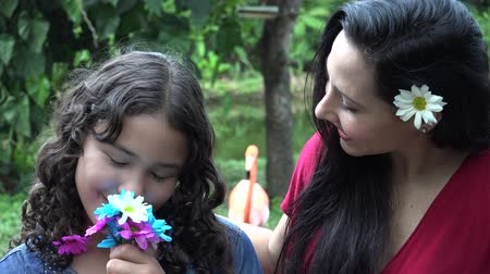 hayran olmak : Caring Mother and Daughter with Flowers Stok Video