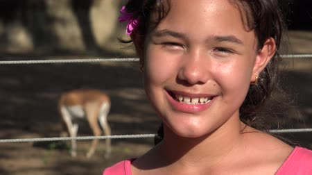 eighteen : Girl Posing with Deer at Zoo