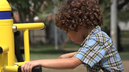 plac zabaw : Curly Haired Boy at Playground