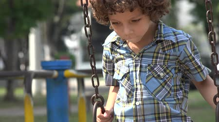 plac zabaw : Boy Swinging on Swing Set