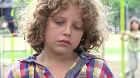 companionship : Sad Young Boy at Playground Stock Footage