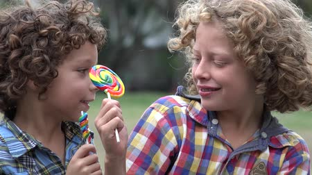 taunting : Brothers Eating Lollipop Candy