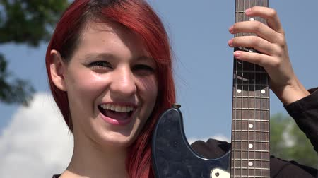 acoustical : Confused Teen Redheaded Female With Guitar Stock Footage