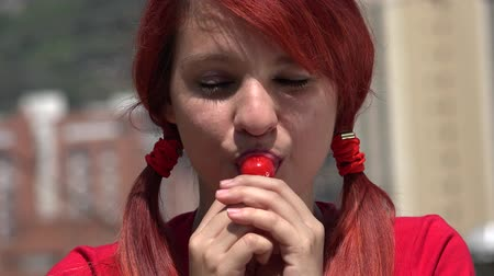 леденец : Adorable Female Teen Redhead With Lollipop