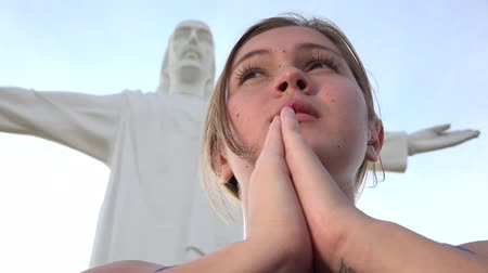 jezus : Praying At Jesus Statue