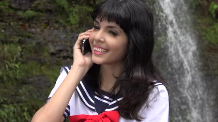 caracteres : Cosplay Girl Using Cell Phone Stock Footage