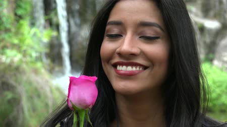 fuksja : Pretty Hispanic Woman With Pink Flower