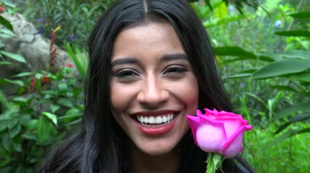 fuksja : Smiling Woman With Pink Flower