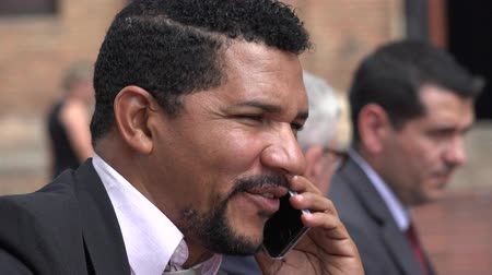 on the phone : Hispanic Or African Business Man Talking On Cell Stock Footage