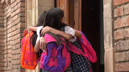 seminair : School Girls Hug Say Hello Stockvideo