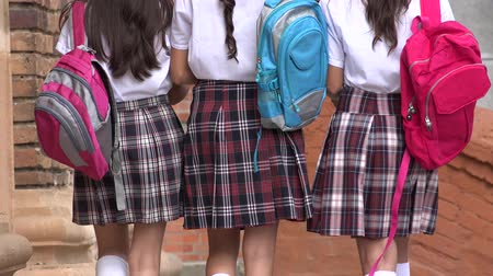 okula geri : School Girls Walking With Backpacks