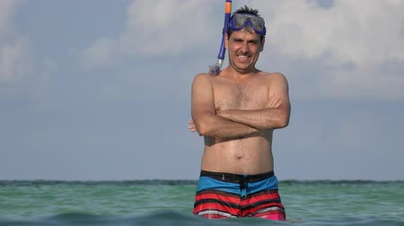 maço : Male Tourist Summer Vacation At Ocean Wearing Bathing Suit And Snorkel