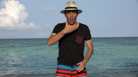 coringa : Funny Goofy Man On Summer Vacation At Ocean Stock Footage