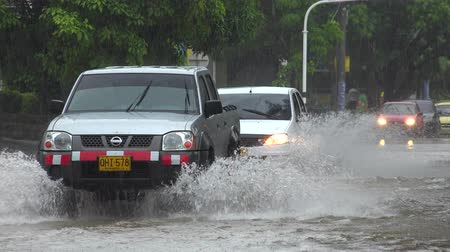 floods : Cars Driving On Flooded Street