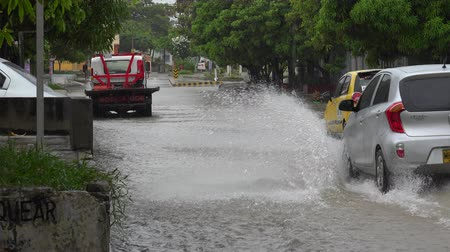 floods : Tow Truck And Cars On Flooded Street Stock Footage