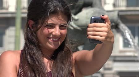 fotky : Woman Having Fun Taking Selfies Dostupné videozáznamy