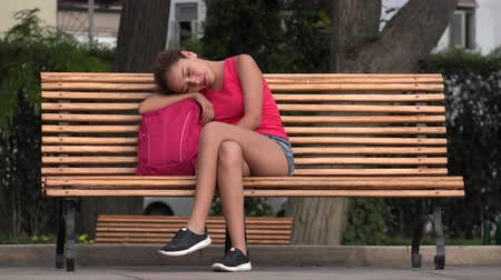 ławka : Female College Student Resting On Park Bench Wideo