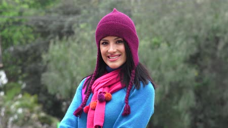 chicano : Smiling Hispanic Woman Wearing Sweater And Knit Hat Cold Weather Stock Footage