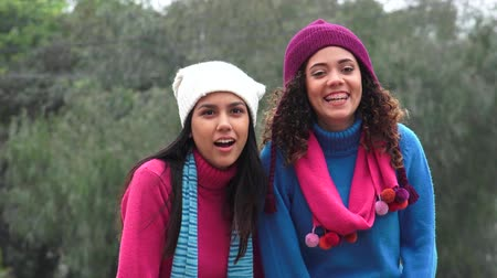 cimborák : Friends Pointing Wearing Sweaters Cold Weather