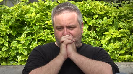 talep : Fat Man Praying Or Thinking