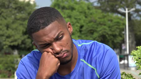Tired Or Confused Black Male Athlete Wideo