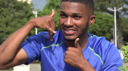 maço : Black Male Athlete And Cell Phone Gesture Stok Video