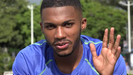 maço : Black Male Athlete Waving Hello Goodbye