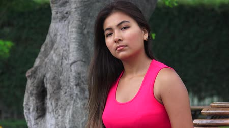 fuksja : Serious Female Hispanic Teen Wearing Pink