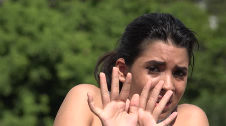 alarmed : Fearful Hispanic Pretty Teen Girl Stock Footage